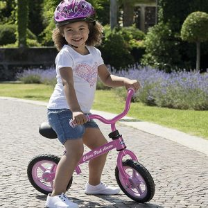 Niña sobre su bicicleta sin pedales Chicco rosa